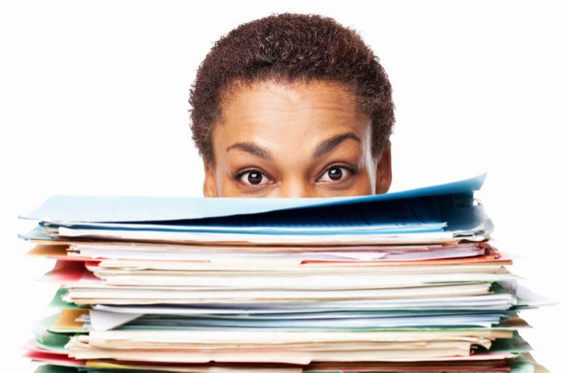 Stacks of file folders_peering over the work