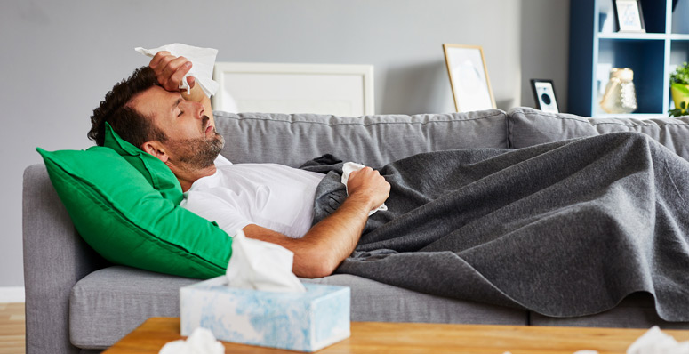 Man-not-well-sick-on-couch