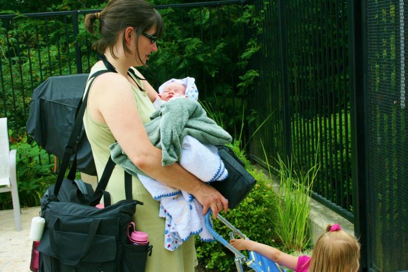 Mom with two young kids_MrsFlinger via FlickrCC