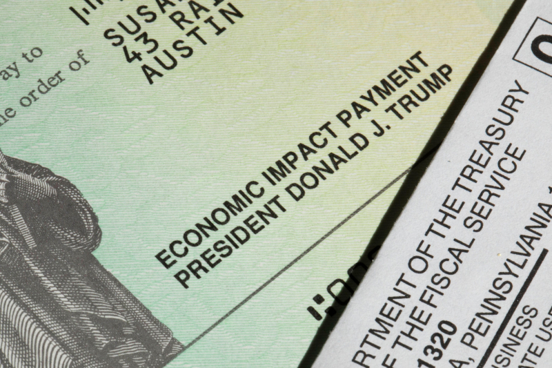 Trump signature on COVID relief payment check closeup