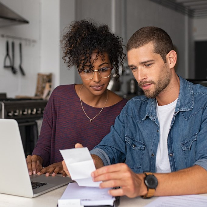 Couple checking and paying bills electronically
