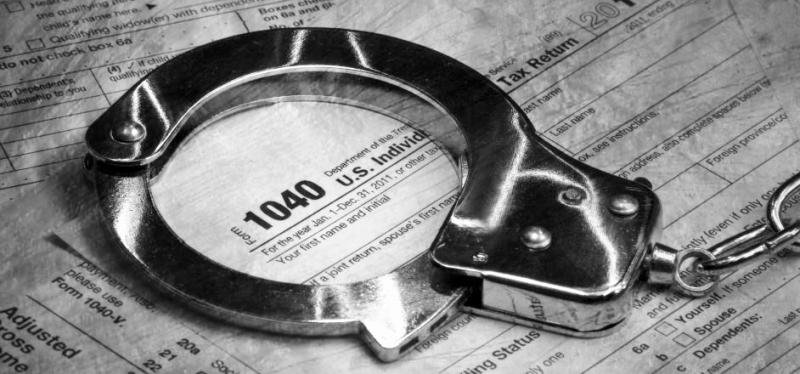 Tax 1040 form with handcuffs