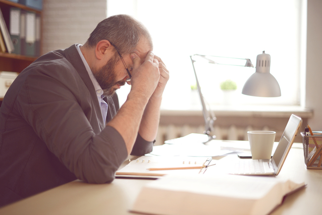 Worried Man Working at Computer