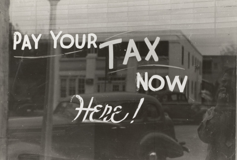 Pay your tax now window sign