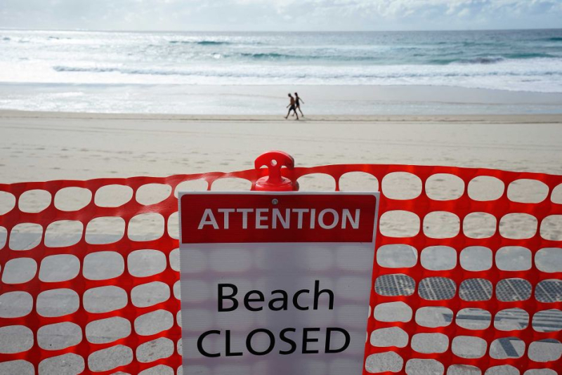 Beach closed_scofflaws walking_AAP-Dave-Hunt