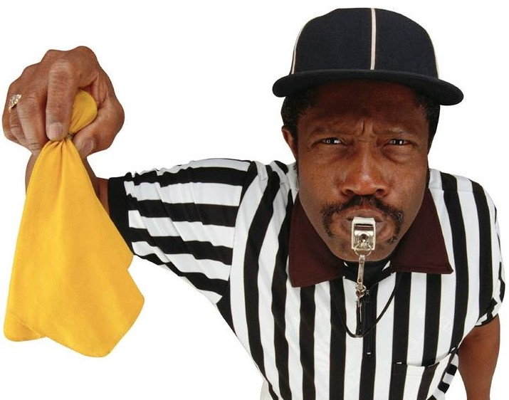 Footballl referee with penalty flag cropped