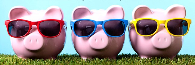 Piggy banks in grass with sunglasses cool