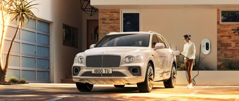 Bently Bentayga Hybrid SUV being recharged by owner_cropped