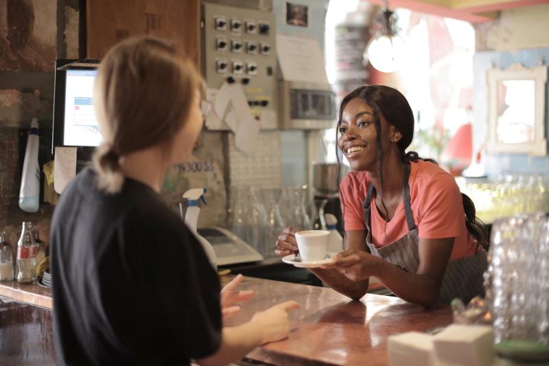 Young woman serving coffee_pexels-andrea-piacquadio-3796810