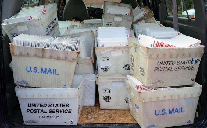 Bins of US Postal Service mail