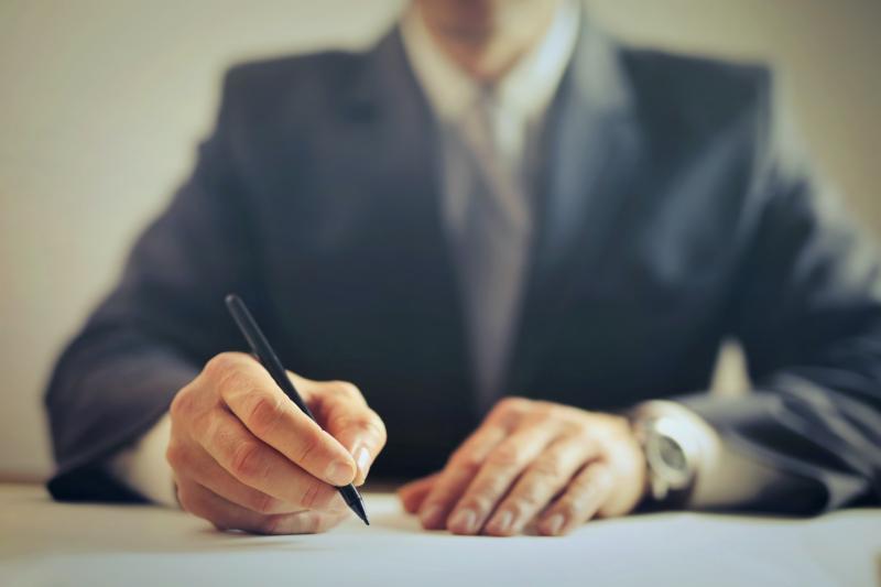 Man signing documents_andrea-piacquadio via pexels