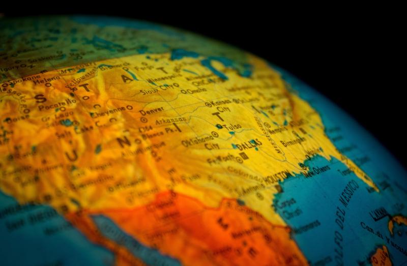 Us-on-globe-pexels-antonio-quagliata-227433-2