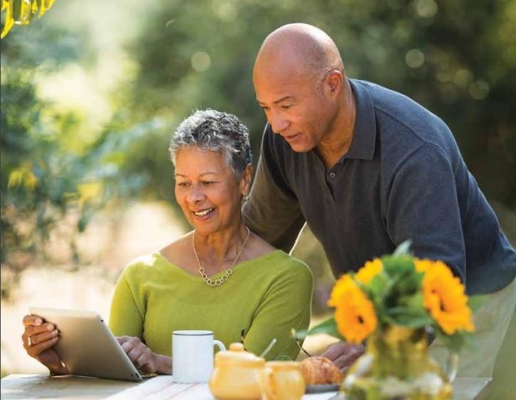 Couple reviewing finances_Wells Fargo retirement plan report