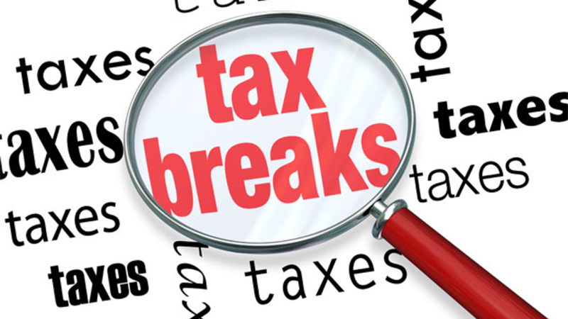 Tax breaks magnifying glass words