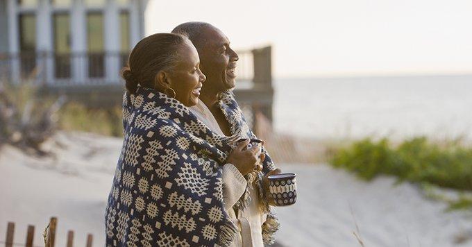 Older couple enjoying a morning on the beach