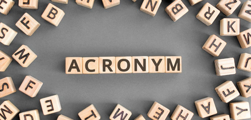 Acronym spelled out in small wooden blocks_1000x480