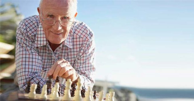 Senior citizen playing chess in the park