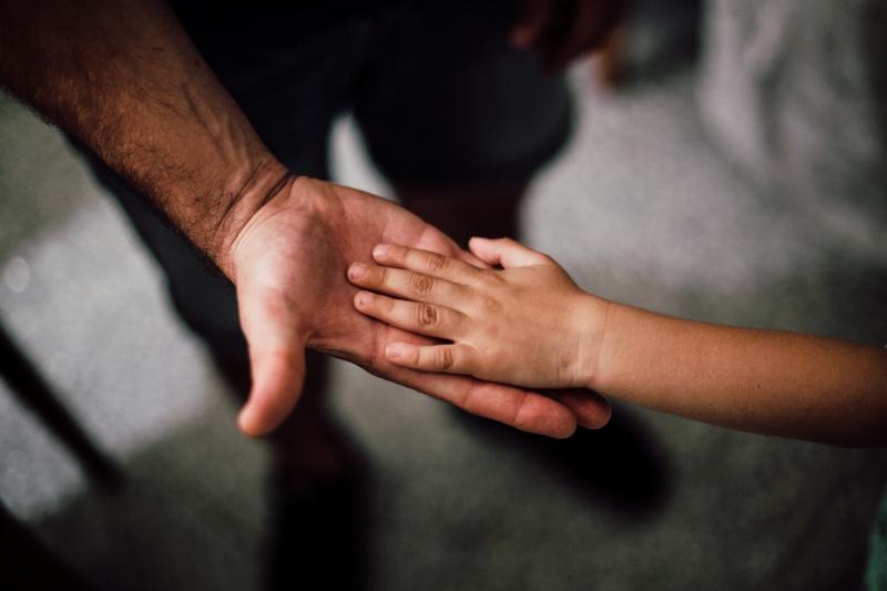 Adult-child-hands_pexels-juan-pablo-serrano-arenas-1250452