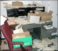 Stacks_of_documents_at_desk_1